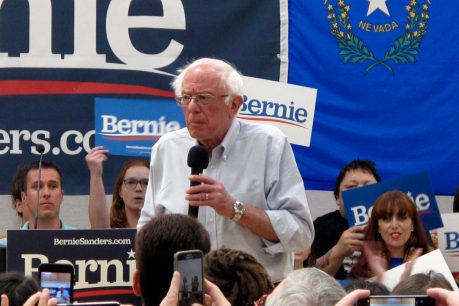 Sanders attacks moderate rivals as voting begins in Nevada