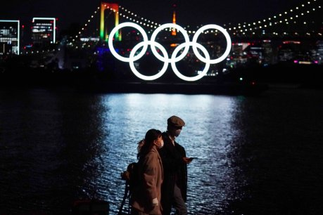 The Latest: Road blocks up, virus cases down for Tokyo Games